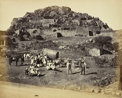 General view inside Fort, with Europeans and party posed in foreground, Chitradurga